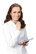 Happy young business woman with notepad writing, isolated