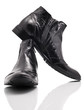 Pair of leather mens boots on white