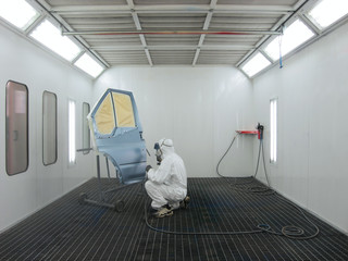 painter works in a spray booth