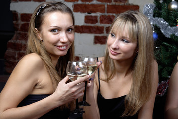 two young women drinking champagne