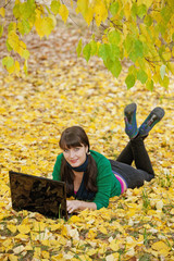 girl with a yellow autumn foliage