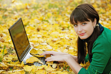 beautiful girl  resting on autumn leaves