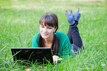 Active beautiful  sexy girl relaxing with laptop