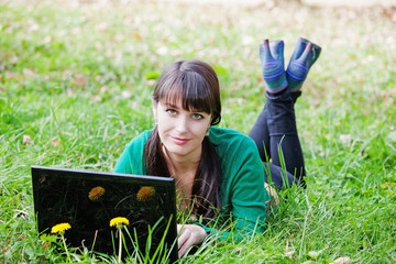Active beautiful  girl relaxing with laptop