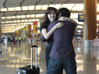 Asian Chinese girl greeted by boyfriend at the airport