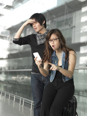 Asian Chinese couple dismayed over their flight schedule