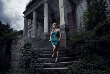 beautiful blonde woman goes down the stairs