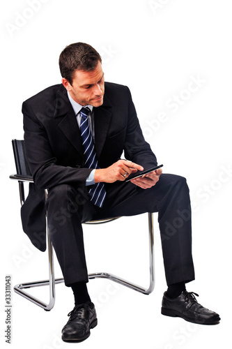 business man with tablet-pc sitting on a chair