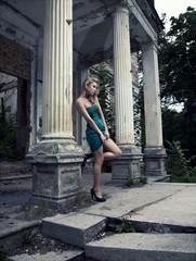 blonde woman posing outdoors