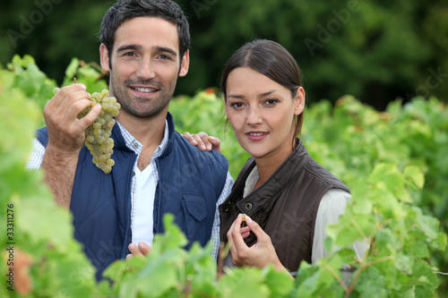 young couple proud of their vineyard