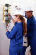 a young female electrician and man electrician