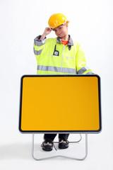 little boy in a costume of roadworks employee