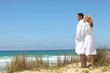 couple in robes on the beach