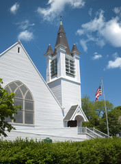Old white new england church located on Cape Cod, MA