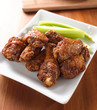 pile of buffalo wings with celery