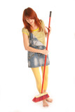 young beautiful girl with apron and broom poster