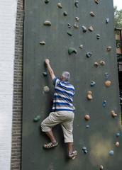 man and wall climbing
