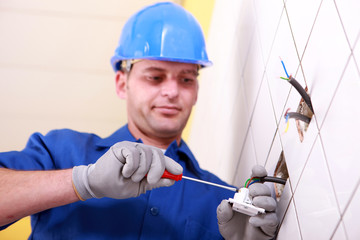 Electrician using screwdriver