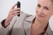 businesswoman holding a cell-phone