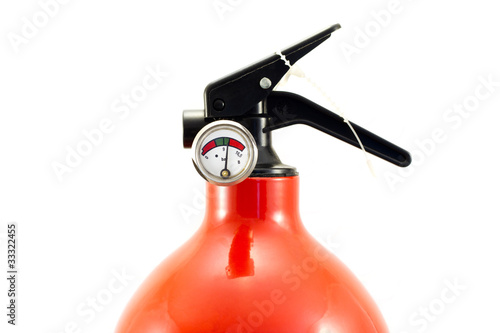 Fire extinguisher closeup with pressure manometer on white