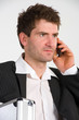 businessman with phone and dispatchcase