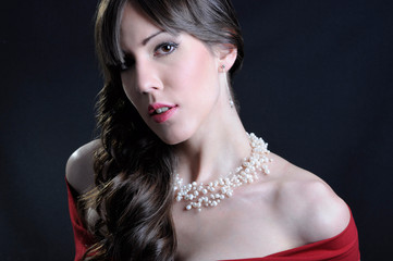 Girl in red dress with pearl necklace