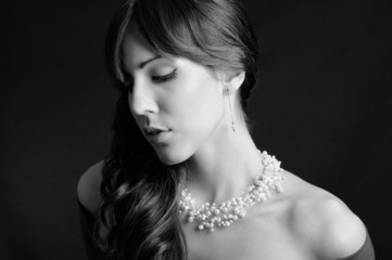 Sensual girl with pearl necklace, black and white