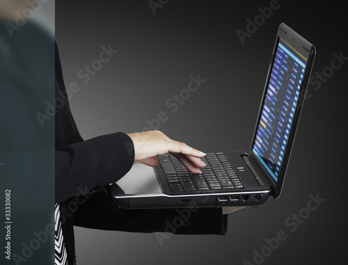 businessman's hands on notebook keyboard in the office