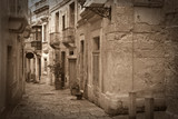 Fototapety Retro photo of old narrow  street
