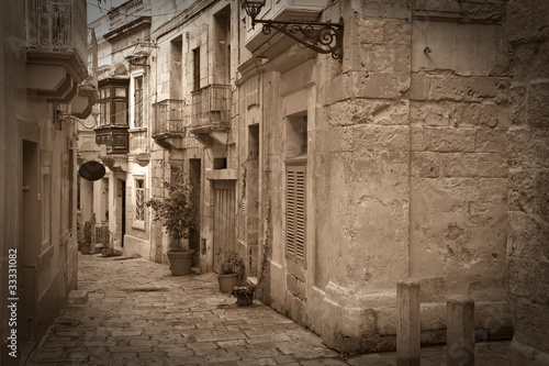 Retro photo of old narrow  street