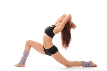 Beautiful slim fitness woman stretching exercise