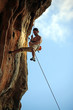 Rock climber against blue sky