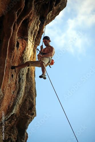 Rock climber against blue sky