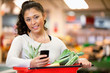 Woman with Shopping List on Phone