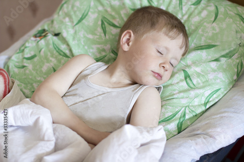 Little boy sleeps in his bed von jura, lizenzfreies Foto #33335423 ...