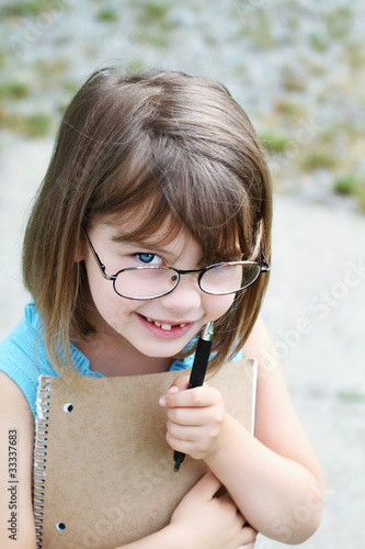 Child with Pen and Book
