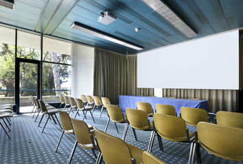 interior of a conference hall, room with many chairs