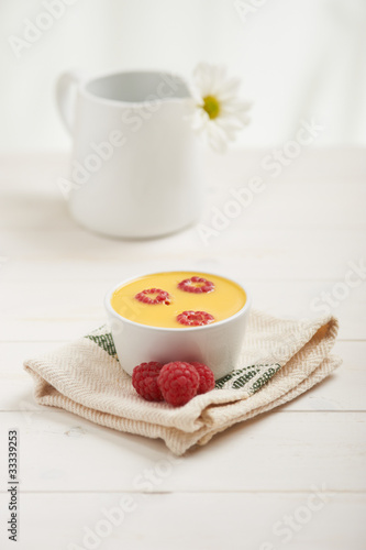 raspberry custard on a napkin, in background white flower