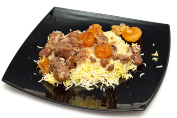 Caucasian traditional pilaf. Rice with meat and fruit
