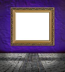 old  elegant golden frame on red plaster rough background and vi