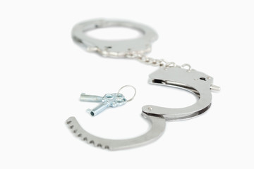 Close up of handcuffs and keys