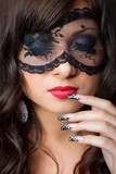 sensual brunette girl with lacy mask on her eyes poster