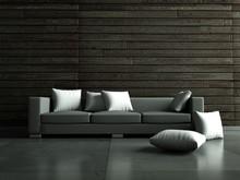 Szara kanapa przed drewnianej ścianie