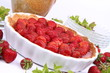 Strawberry Tart decorated with strawberries and mint twigs