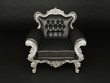 Luxurious black  armchair with silver frame on the background