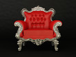 Luxurious red armchair on the black background