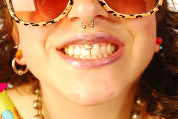 A smile (thirty-two teeth) between the piercing