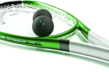 Green squash racket with balls on white