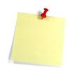 Gelber Merkzettel mit rotem Pin