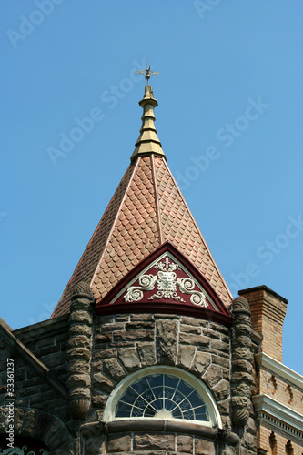 Weather vane on top of an old building